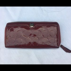 COACH BURGUNDY PATENT LEATHER WALLET